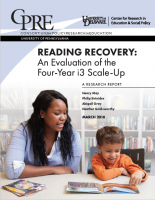 The image features the cover for Reading Recovery with a young boy reading a book while a woman supports his reading.